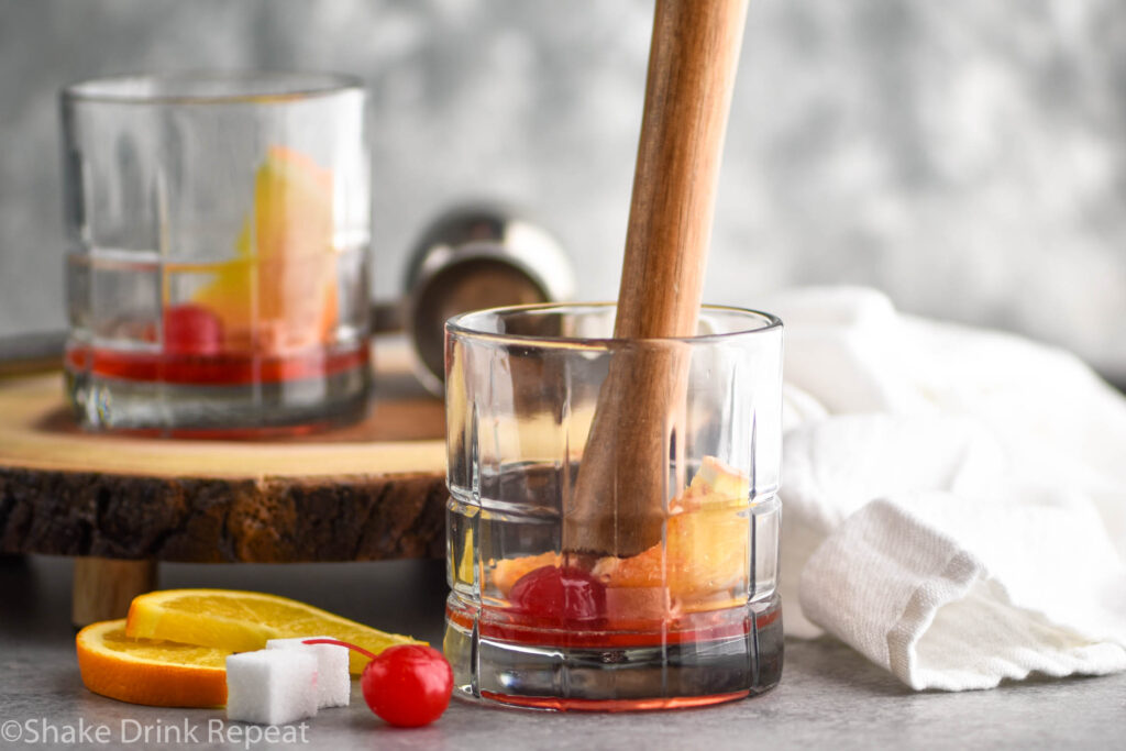 glass of muddled wisconsin old fashioned ingredients