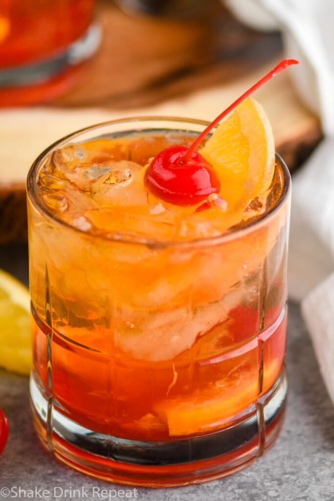 glass of wisconsin brandy old fashioned with ice, brandy, cherry, and orange