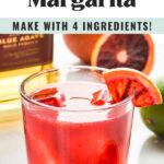 glass of blood orange margarita with ice, tequila, and blood orange wedge garnish