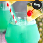 glass of blue hawaii with ice, cherry, pineapple, and a straw