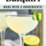 glass of daiquiri with a lime twist