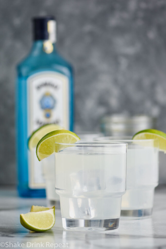 two glasses of gin gimlet with ice and lime