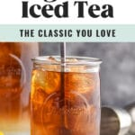 man stirring glass of long island iced tea with ice and lemon wedge