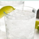 glass of vodka soda with ice and lime