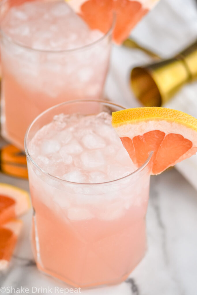 two glasses of paloma cocktail with crushed ice and grapefruit