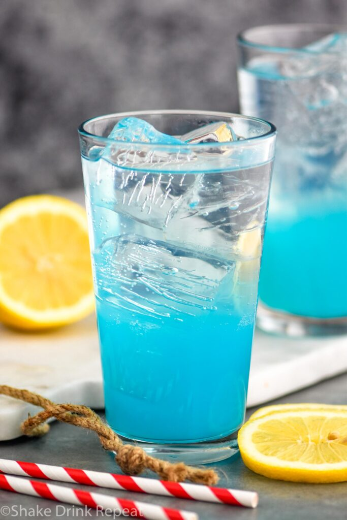 glass of walk me down with ice, straws and lemon slices