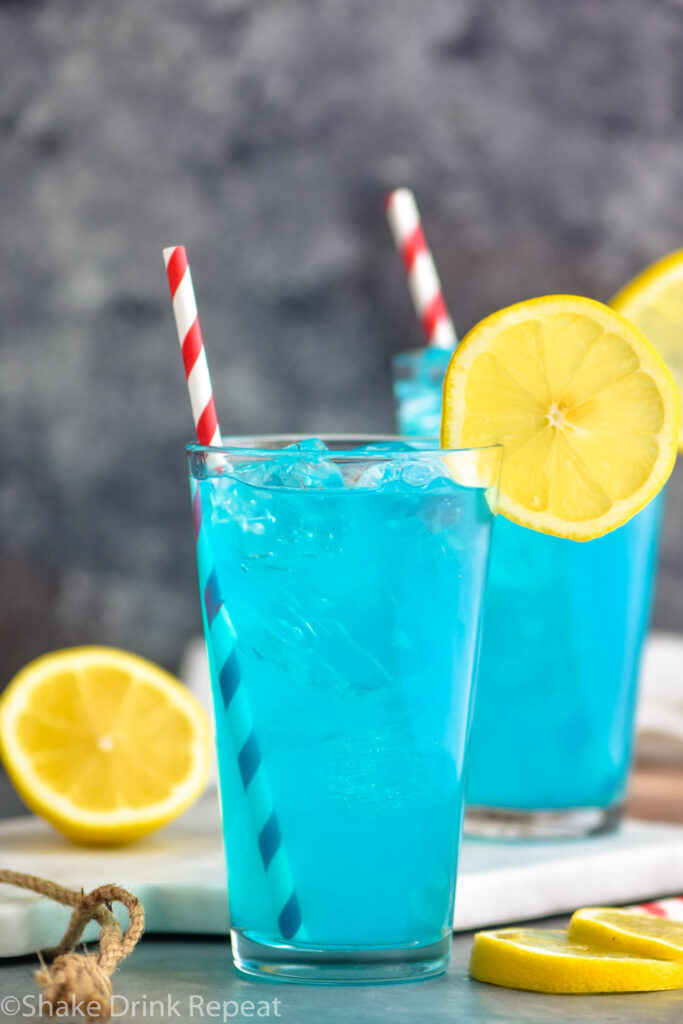two glasses of walk me down with ice, straws, and lemons