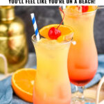 two glasses of bahama mama with ice, fresh orange slices, and cherry garnish surrounded by drink umbrella and straws