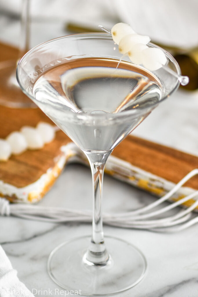 glass of gibson garnished with cocktail onions