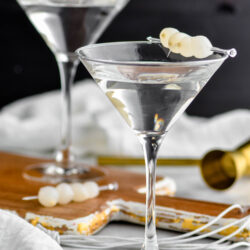 two glasses of gibson with cocktail onion garnish