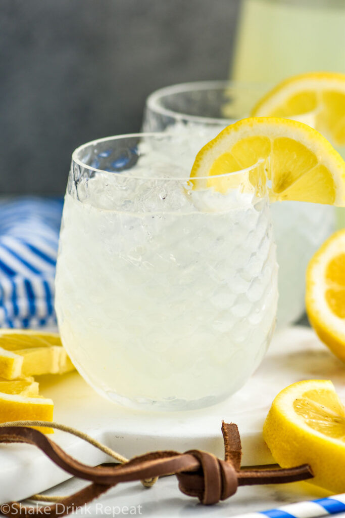 two glasses of vodka lemonade with ice and slices of lemon