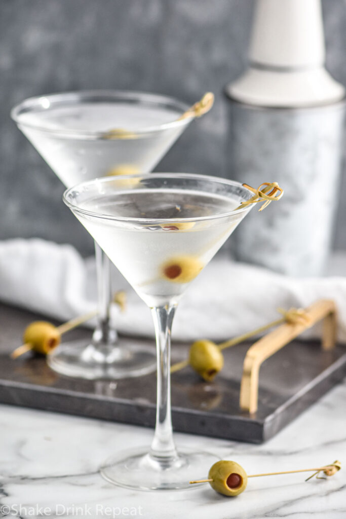 two glasses of Vodka Martini with olives as garnish