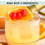 glass of tequila sunset with ice and cherry and orange slice garnish