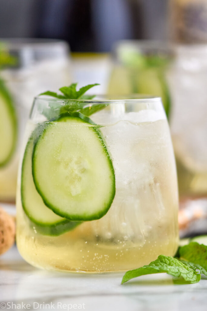 glass of Lillet Spritz with fresh mint leaves and cucumber slices