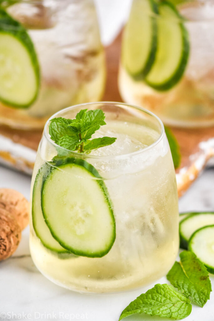 glasses of Lillet Spritz with ice, fresh mint leaves, and cucumber slices