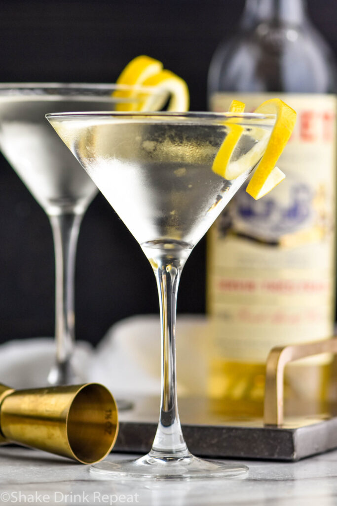two martini glasses of Vesper Martini with lemon twist garnish