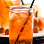 two glasses of Drunk Pumpkin with ice, straw, and pumpkin candies